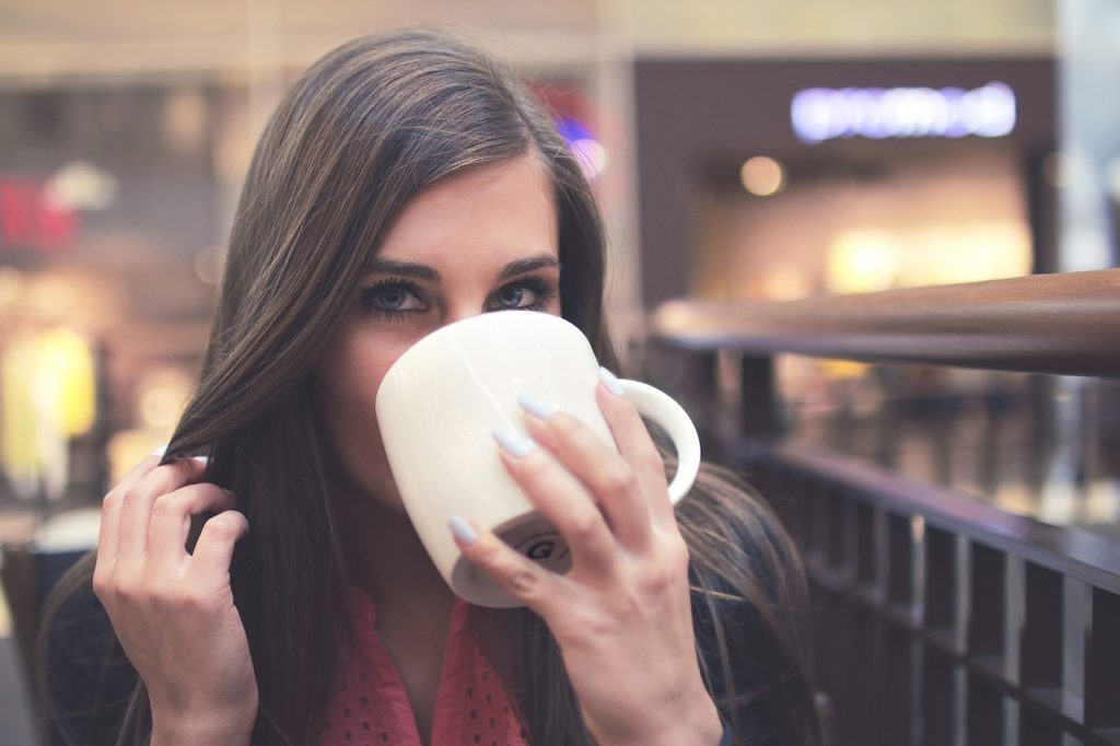 woman drinks coffee made with bulletproof recipe